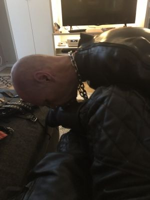 slave working on My boots