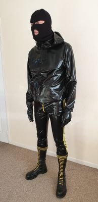 Rubbered Boss ready for  house invasion of a fag