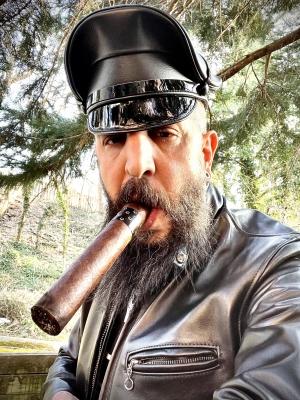Enjoying an Asylum 8x80 cigar wearing leather on this fine day.